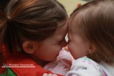 Sisters share a snuggle